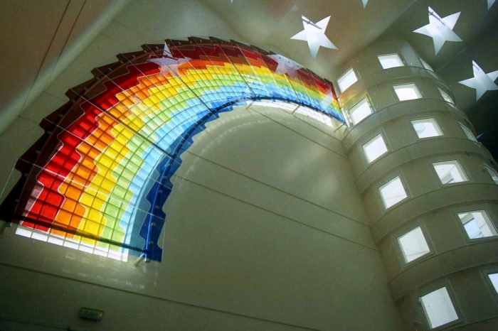 Artistic glass rainbow by Archiglass, Tomasz Urbanowicz at the College George Brassens in Paris, France. All rights reserved.